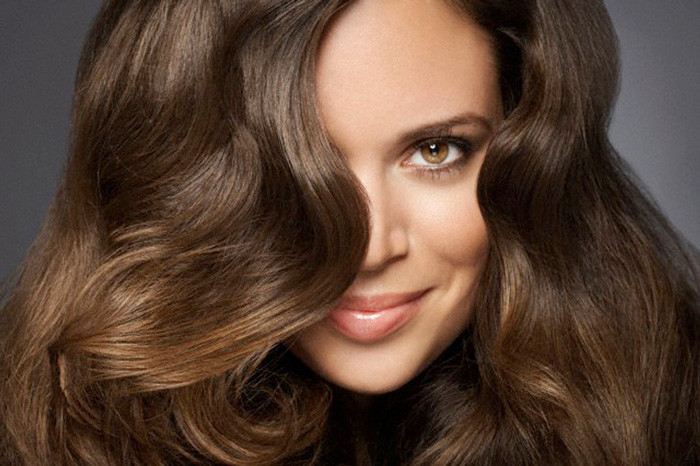 Woman with wavy hair --- Image by © Ada Summer/Corbis