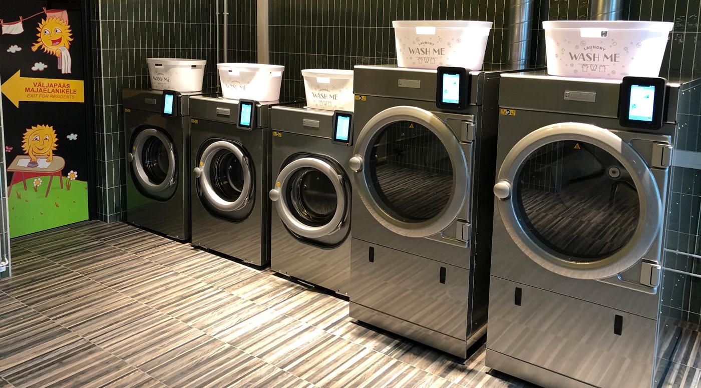 В Юлемисте открылась современная прачечная, круглосуточно доступная для жильцов дома
