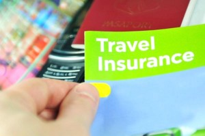 Travel insurance concept with hand holding information leaflet